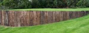 Rustic sleepers in vertical retaining wall
