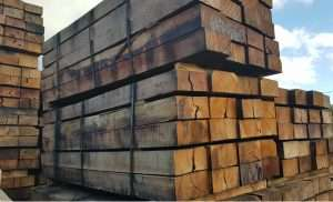 bundles of railway sleepers stacked
