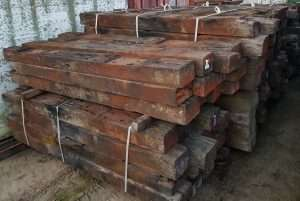 Used hardwood railway sleepers bundled and stacked